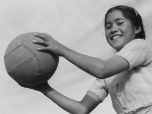 Girl with volley ball, Manzanar Relocation Center, 1943 by Ansel Adams