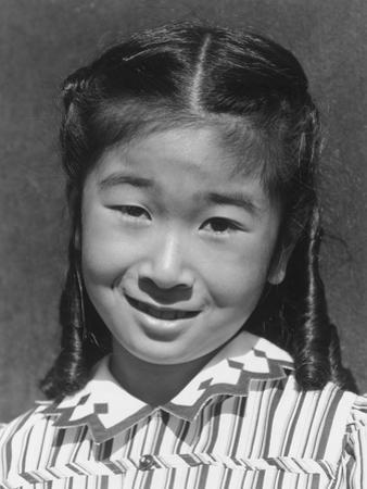 Joyce Yuki Nakamura at Manzanar, 1943 by Ansel Adams