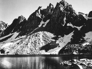 """""""Kearsarge Pinnacles,"""" Partially Snow-Covered Rocky Formations Along the Edge of the River by Ansel Adams"""