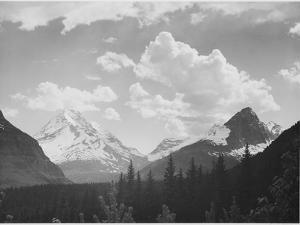 """Looking Across Forest To Mountains And Clouds """"In Glacier National Park"""" Montana. 1933-1942 by Ansel Adams"""