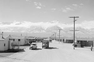 Manzanar street scene, spring, Manzanar Relocation Center, 1943 by Ansel Adams