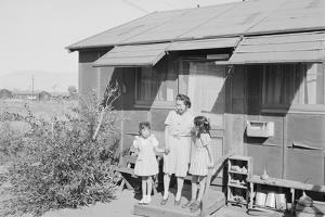 Mrs. Naguchi, with Louise Tami Nakamura and Joyce Yuki Nakamura at Manzanar, 1943 by Ansel Adams