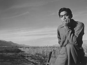 Tom Kobayashi at Manzanar Relocation Center, California, 1943 by Ansel Adams