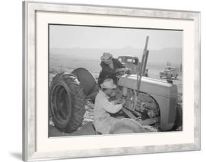 Tractor Repair: Driver Benji Iguchi, Mechanic Henry Hanawa, Manzanar Relocation Center, California by Ansel Adams