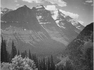 "Valley Snow Covered Mountains In Background ""In Glacier National Park"" Montana. 1933-1942 by Ansel Adams"