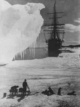 """Antarctic Expedition of Robert Scott on Ice with Ship """"Terra Nova"""" Anchored in Background"""