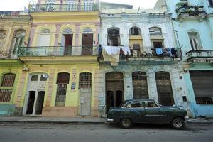 Cuba, La Havana, Old American Cars Driving Through Colonial Streets by Anthony Asael