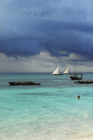 Tanzania, Zanzibar, Nungwi, Traditional Sailing Boat with Storm