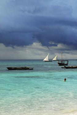 Tanzania, Zanzibar, Nungwi, Traditional Sailing Boat with Storm by Anthony Asael
