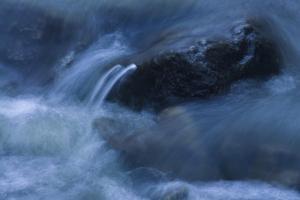 Rock Poking Through Swirling Warter by Anthony Paladino