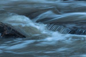 Water Twisting Around Boulders by Anthony Paladino