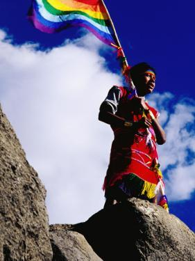 Flag Bearer at Ancient Incan Inti Raymi Festival at Sacsayhuaman, Above Cuzco by Anthony Pidgeon