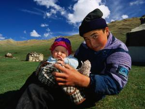 Boy and Baby in Front of Yurt Camp, Kyrgyzstan by Anthony Plummer