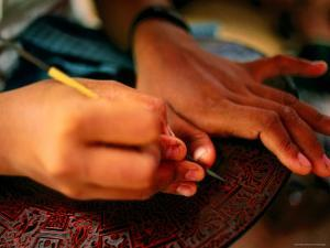 Detail of Girl's Hands Carving Lacquerware, Bagan, Mandalay, Myanmar by Anthony Plummer
