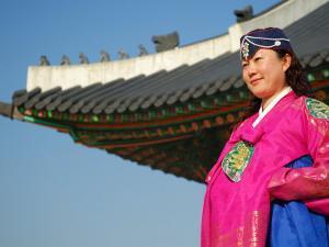 Gyeongbokgung Palace, Woman in Traditional Hanbok Dress, Gwanghwamun, Seoul, South Korea by Anthony Plummer