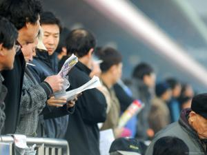People Studying Form Guide at Seoul Racecourse, Seoul, South Korea by Anthony Plummer