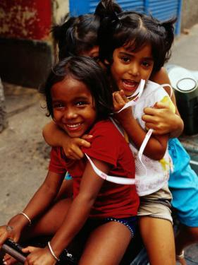 Portrait of Children Sitting on Motorbike, Chowringee, India by Anthony Plummer