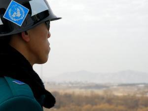 South Korean Rok Soldier in Joint Security Area Looking to the North Across Dmz, Seoul, South Korea by Anthony Plummer
