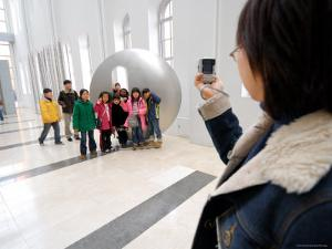 Woman Taking Group Photo Inside Seoul Museum of Art, Myong-Dong, Seoul, South Korea by Anthony Plummer