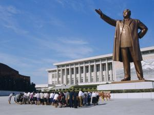 Commune Group Brought to Bow to Great Leader on Grand Monument, Pyongyang, North Korea, Asia by Anthony Waltham