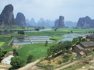 Farmland and Rock Formations of Guangxi, Guilin Province, China by Anthony Waltham
