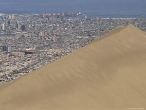 Giant Sand Dune Above Large City, Iquique, Atacama Coast, Chile, South America by Anthony Waltham
