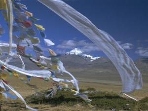 Prayer Flags on Top of Low Pass on Barga Plain, with Mount Kailas (Kailash) Beyond, Tibet, China by Anthony Waltham