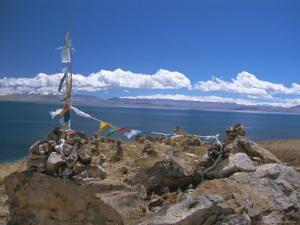 Prayer Flags Over Sky Burial Site, Lake Manasarovar (Manasarowar), Tibet, China by Anthony Waltham