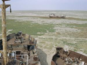 Ship's Graveyard Near Aralsk, on Seabed Due to Water Losses, Aral Sea, Kazakhstan, Central Asia by Anthony Waltham