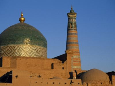 Minaret and Tiled Dome of a Mosque Rise Above the Old City of Khiva