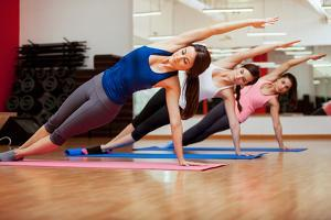 Side Plank Yoga Pose by Three Women by AntonioDiaz
