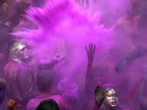 People Painted with Bright Colors Dance During the Festival of Holi on March 7, 2004 by Anupam Nath