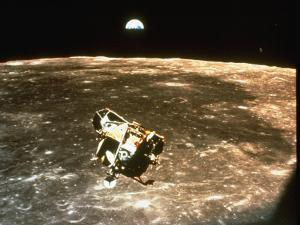 Apollo 11's Lunar Module Flying over the Moon with Earth in the Bkgrd