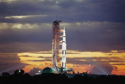 https://imgc.allpostersimages.com/img/posters/apollo-17-and-launch-pad-with-sunrise_u-L-PZOV2K0.jpg?artPerspective=n