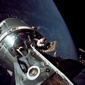 Apollo 9 Astronaut Dave Scott Stands in Open Hatch of Command Module