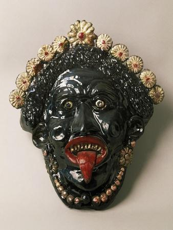 https://imgc.allpostersimages.com/img/posters/apotropaic-mask-used-to-protect-houses-from-evil-eye_u-L-POPQOV0.jpg?p=0