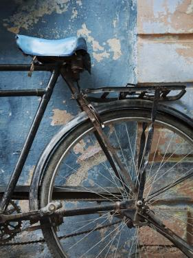 Bicycle Leaning Against Painted Wall by April Maciborka