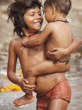 Big Sister Bathing Her Little Brother in Ganges River by April Maciborka