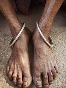 Detail of Old Woman's Feet with Ankle Bracelets by April Maciborka
