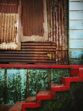Detail of Red Stairs and Corrugated Tin Wall by April Maciborka