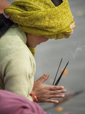 Pilgrim from Nepal Praying to River Ganga by April Maciborka