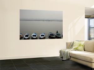 Rowboats Lining Shore of Ganges by April Maciborka