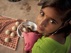Young Girl Preparing Dough for Roti by April Maciborka