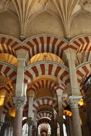 https://imgc.allpostersimages.com/img/posters/arches-of-the-mosque-mezquita-and-cathedral-of-cordoba-cordoba-andalucia-spain_u-L-Q1GYL130.jpg?artPerspective=n