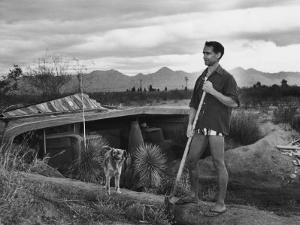 Architect Paolo Soleri Standing Outside His Underground, Concrete House