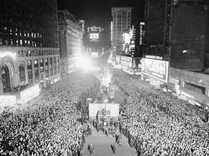 VIEW OF A CROWDED TIMES Square, NEW YORK City, ON NEW YEARS Eve, 1942 by Archive Holdings Inc.