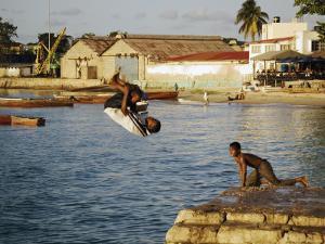 Children Diving in Sea at Waterfront, Stone Town, Zanzibar Town, Zanzibar West, Tanzania by Ariadne Van Zandbergen