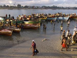 People on Shore Near Fishing Boats, Dar Es Salaam, Tanzania by Ariadne Van Zandbergen