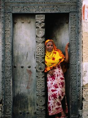 Swahili Girl in Zanzibar Doorway, Bagamoyo, Tanzania by Ariadne Van Zandbergen