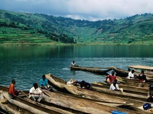 Villagers in Dugout Canoes at Market, Lake Bunyonyi, Kabale, Uganda by Ariadne Van Zandbergen